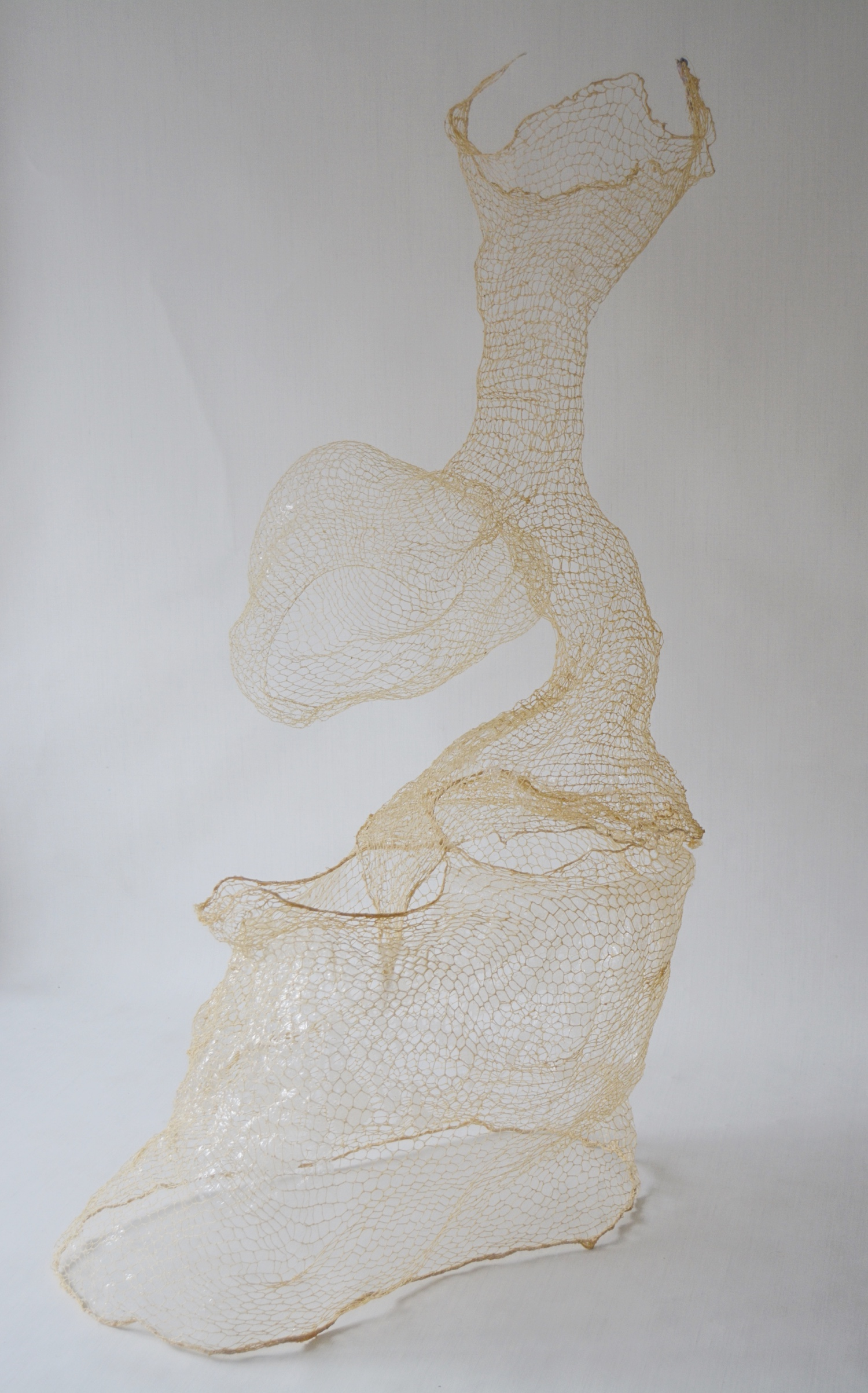 Balance in Between, 2019, Yarn and glue, approximately 61 x 35 x 35 inches, $400