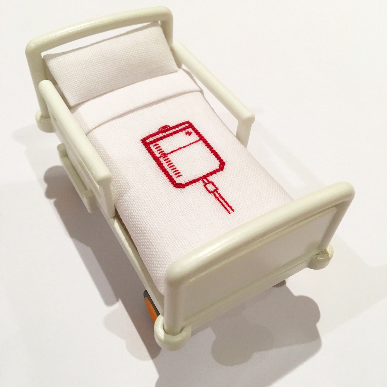 Room for Improvement (detail), 2018, toy bed, cotton, silk threads, 7 cm x 4.5 cm x 4 cm. NFS
