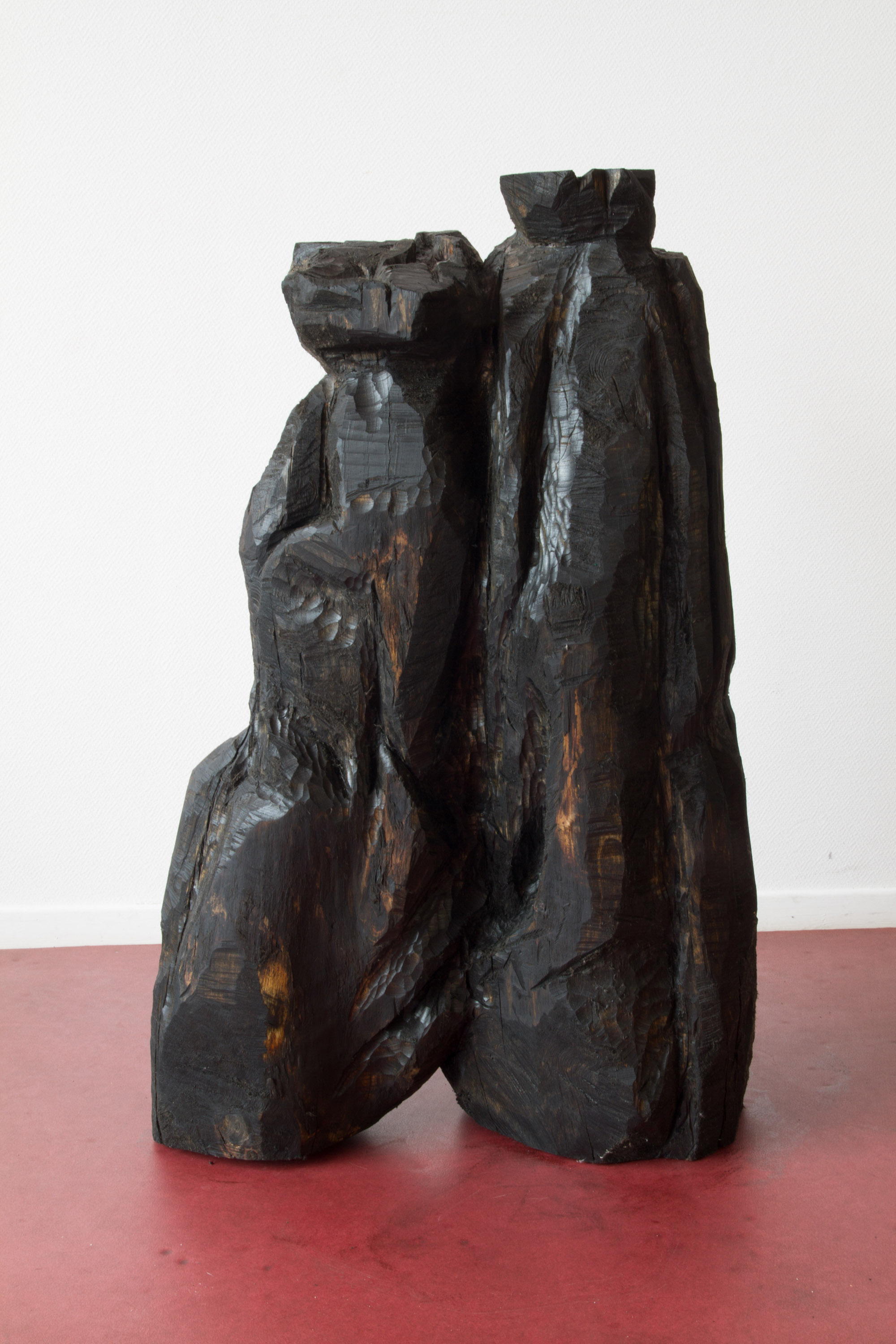 Refuse II (Ordures II), 2016, hand-carved sculpture, found Linden wood and used motor oil patina, 40 cm x 1m 20 x 1m. $5000
