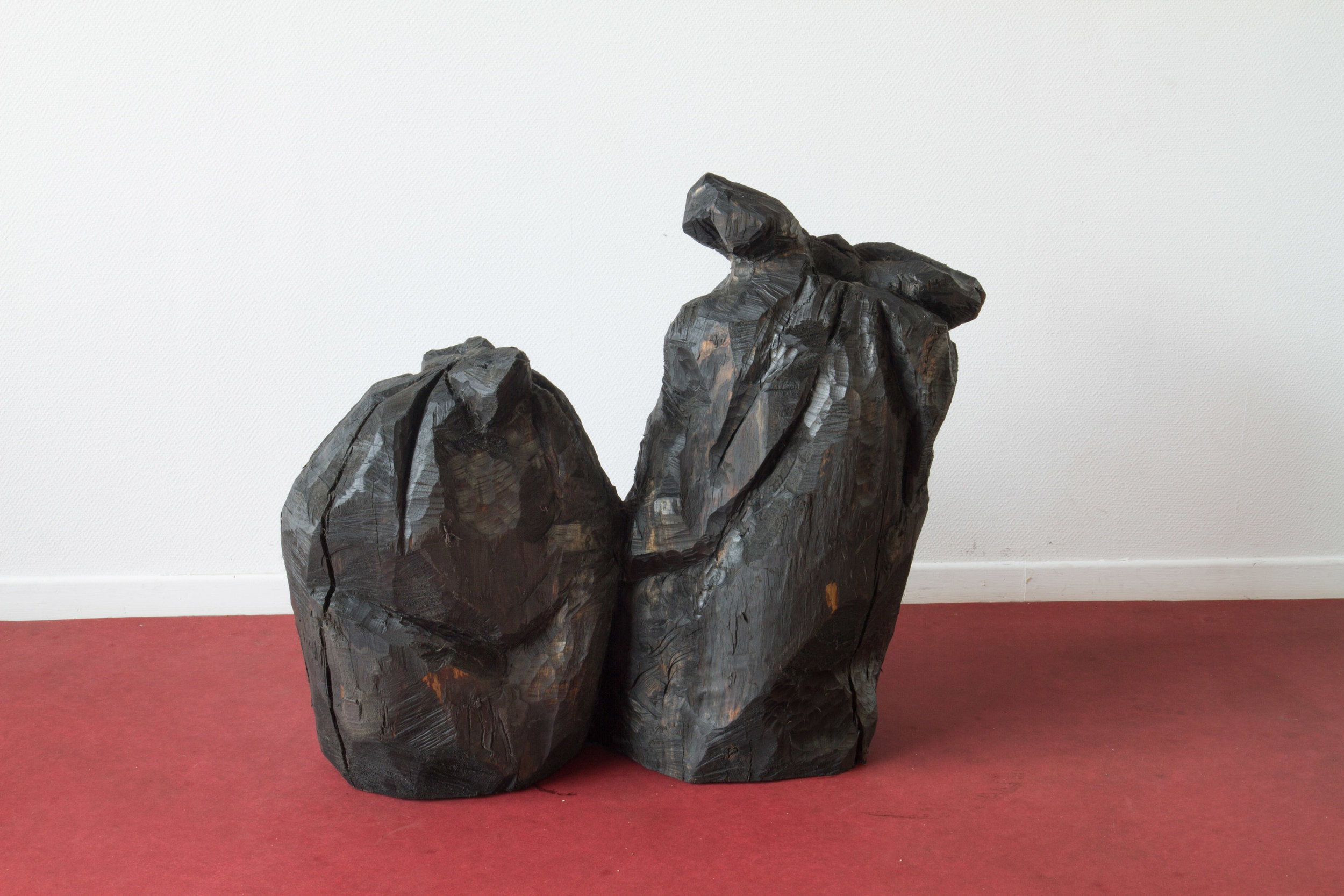 Refuse III (Ordures III), 2016, hand-carved sculpture, found Linden wood and used motor oil patina, 1 m x 1m x 50 cm. $5000