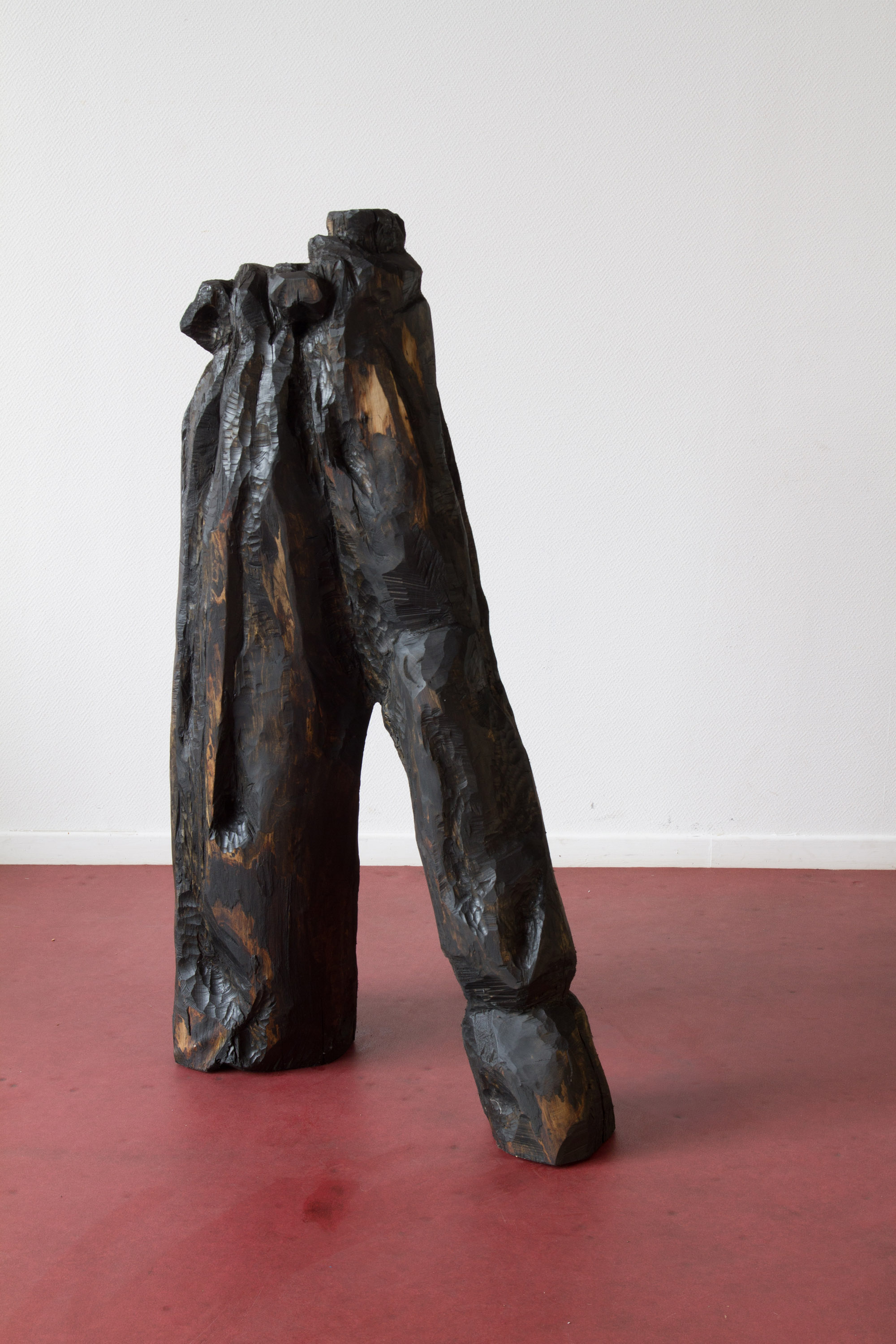 Refuse V (Ordures V), 2016, hand-carved sculpture, found Linden wood and used motor oil patina, 40 cm x 1m 20 x 1m. $5000