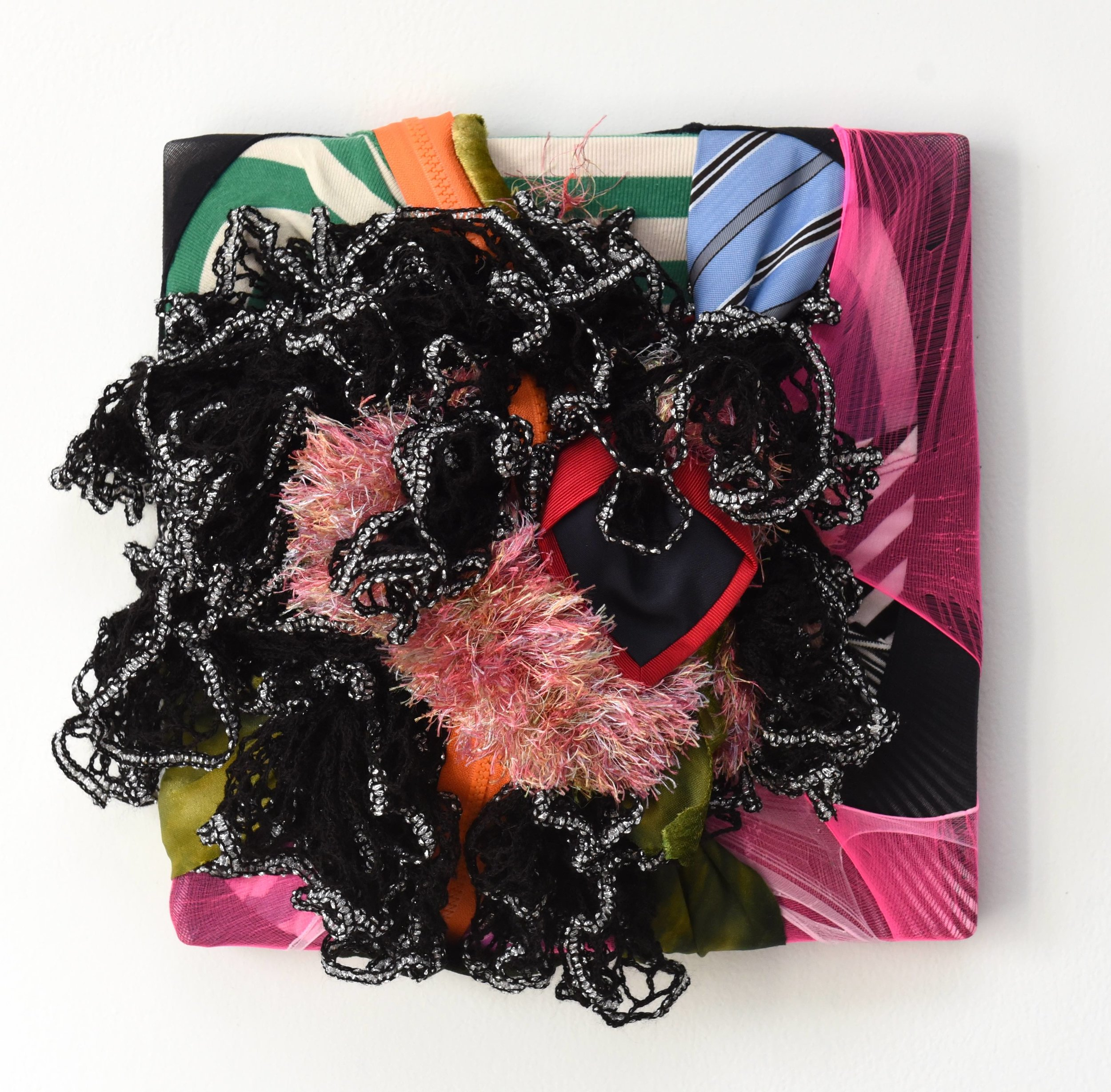 Wall Sculpture 23, 2019, fabric scraps, nylon, zipper and garments on canvas, 12 x 12 x 3.5 in, 850$