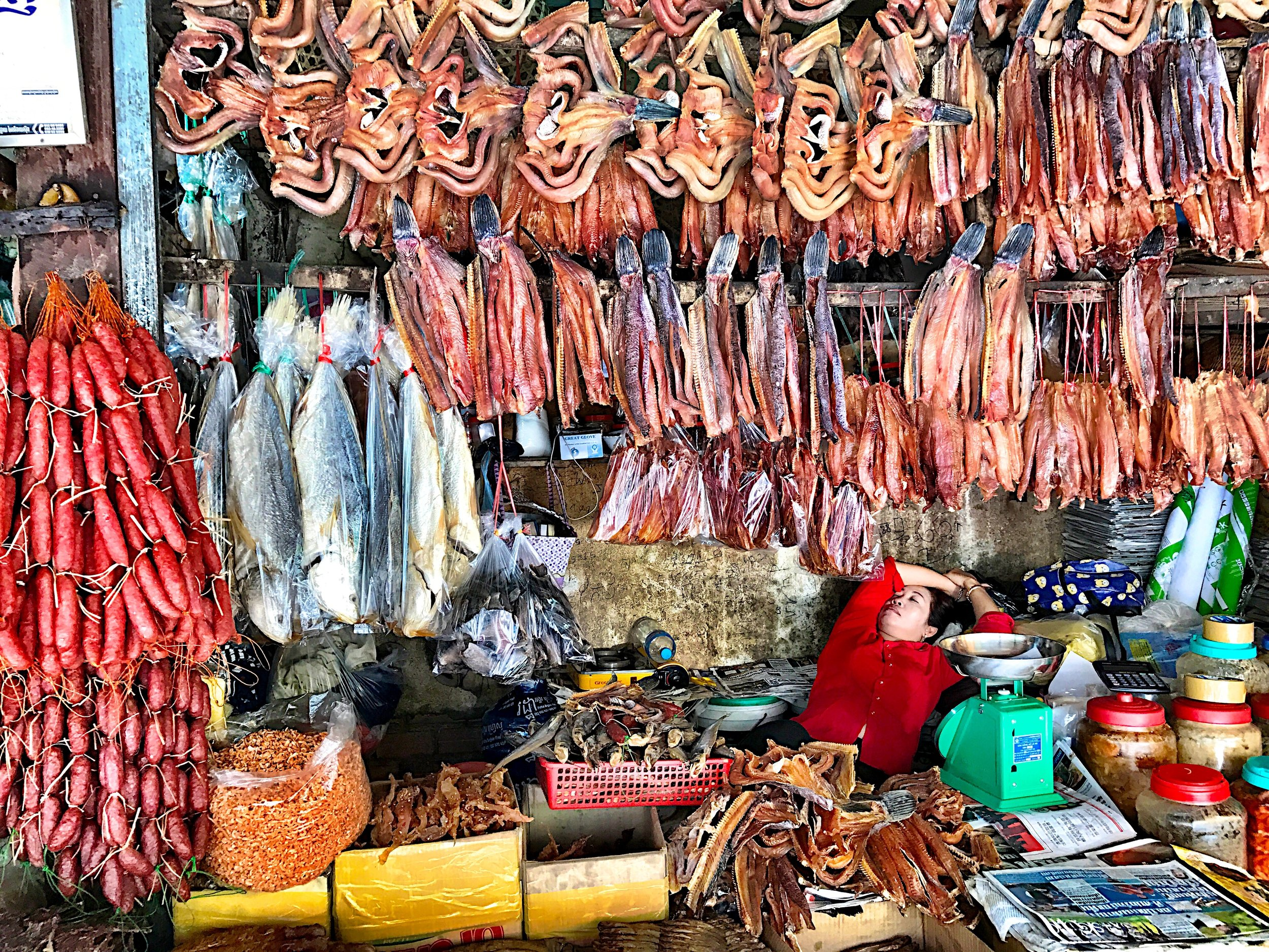 Woman Sleeping in Market Stall, Siem Reap, Cambodia, 2017, Photograph, 22 x 27, 450
