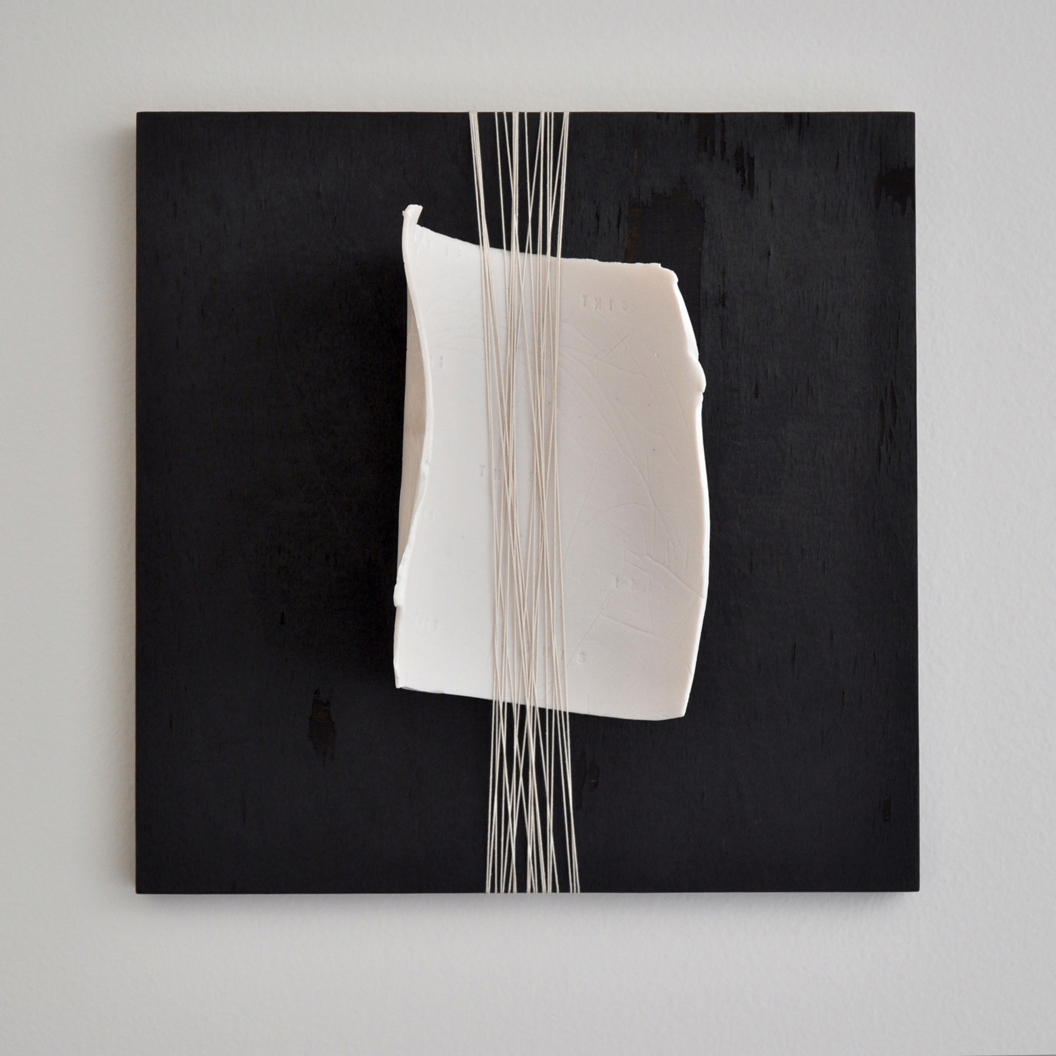 The One v.3, 2019, porcelain, charred wood panel & thread, 12 x 12, $1,200