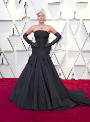 Gaga stole the show on stage and on the carpet in all black Alexander Mcqueen paired effortlessly with a Tiffany yellow diamond necklace.