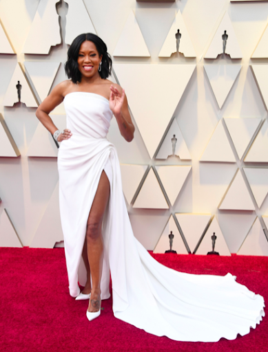 Regina King looking effortlessly breathtaking in Oscar de la renta accessorized with Chopard jewelry and white Christian Louboutin heels.