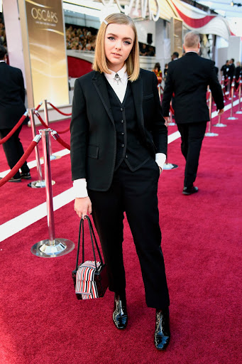 Elsie Fisher redefining feminine fashion in a Thom Browne suit.