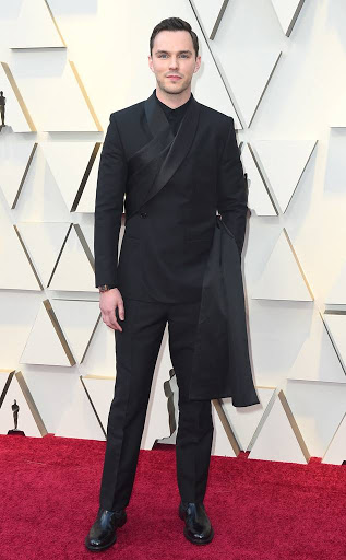 A new approach to the black on black suit, Nicholas Hoult looked dapper in Dior.