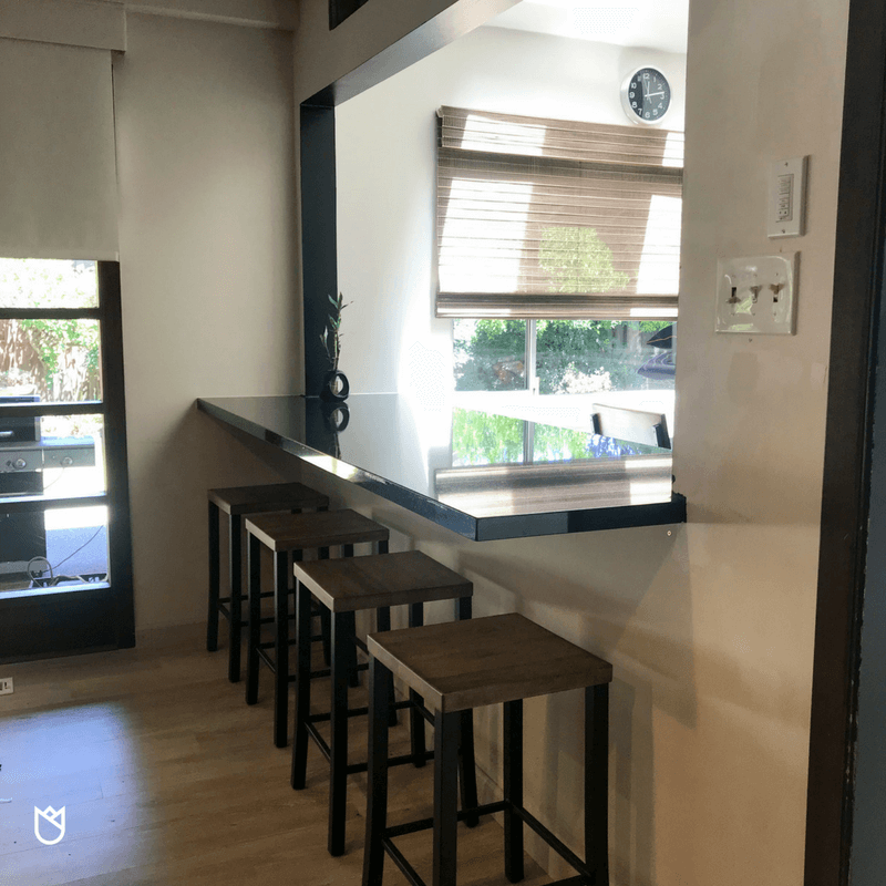 Because we didn't remove a wall, we chose instead to create a bar seating area by making a pass-through to the great room. This was accomplished by cutting a hole in the wall