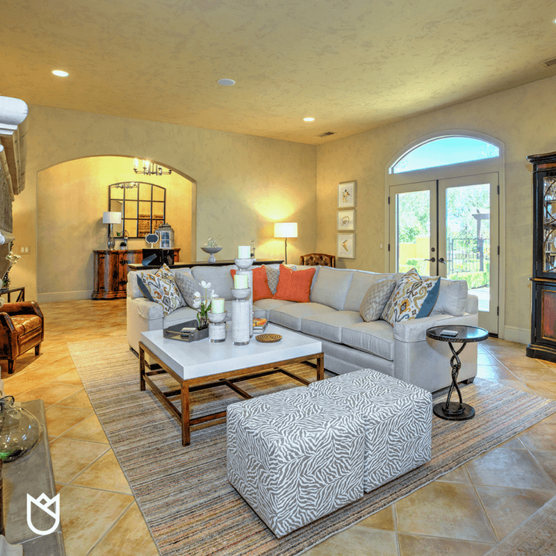 As the daylight floods in, this cozy conversational pit will be perfect for entertaining
