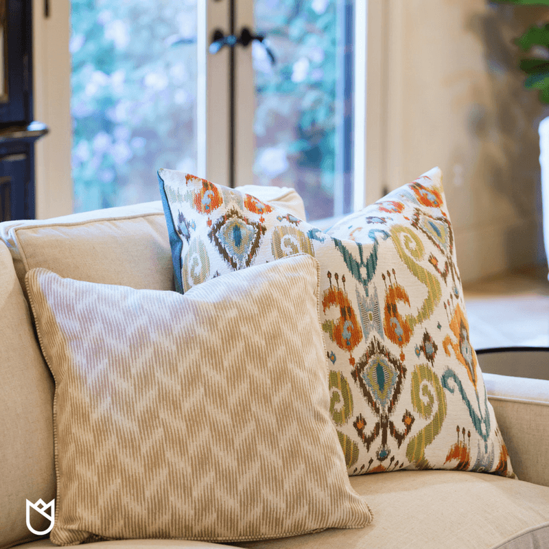 Ikat prints and geometric patterned pillows dress out this sectional