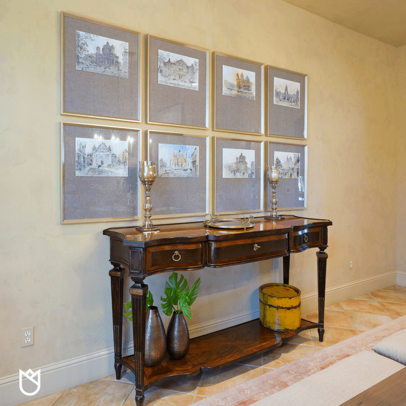 We kept our clients beautiful side board, moving it to another wall with a gallery of watercolor paintings of iconic European destinations