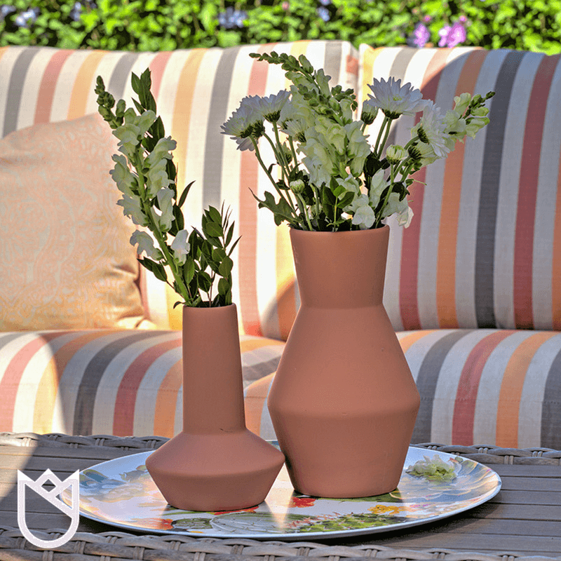 We-suggest-adding-personal-touches-to-your-outdoor-spaces-such-as-lanterns-candles-and-greenery.-Various-colored-and-patterned-pillows-make-the-spaces-feel-just-as-elegant.png