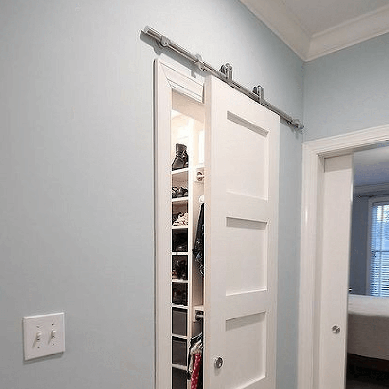 ditch those closet bypass doors and use barn doors instead for a truly professionally designed room