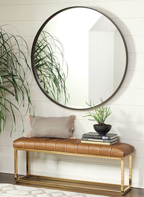 """Thomas Round Mirror   With its clean, unadorned lines, the Thomas Round Mirror epitomizes modern simplicity. The flat metal frame creates a light-filled banded border with just enough depth for contrast with the clear mirror.   Dimensions:  33"""" Mirror: 33"""" Diameter X 2""""D 43"""" Mirror: 43"""" Diameter X 2""""D  Construction:  Handmade of metal frame, mirror, and engineered hardwood.   Buy Now"""