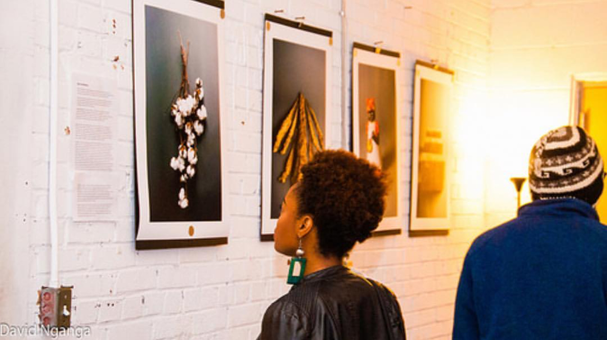 an attendee gazing upon the work of  Derrick Beasley  at YGB: Primary. Photo courtesy of David Nganga.