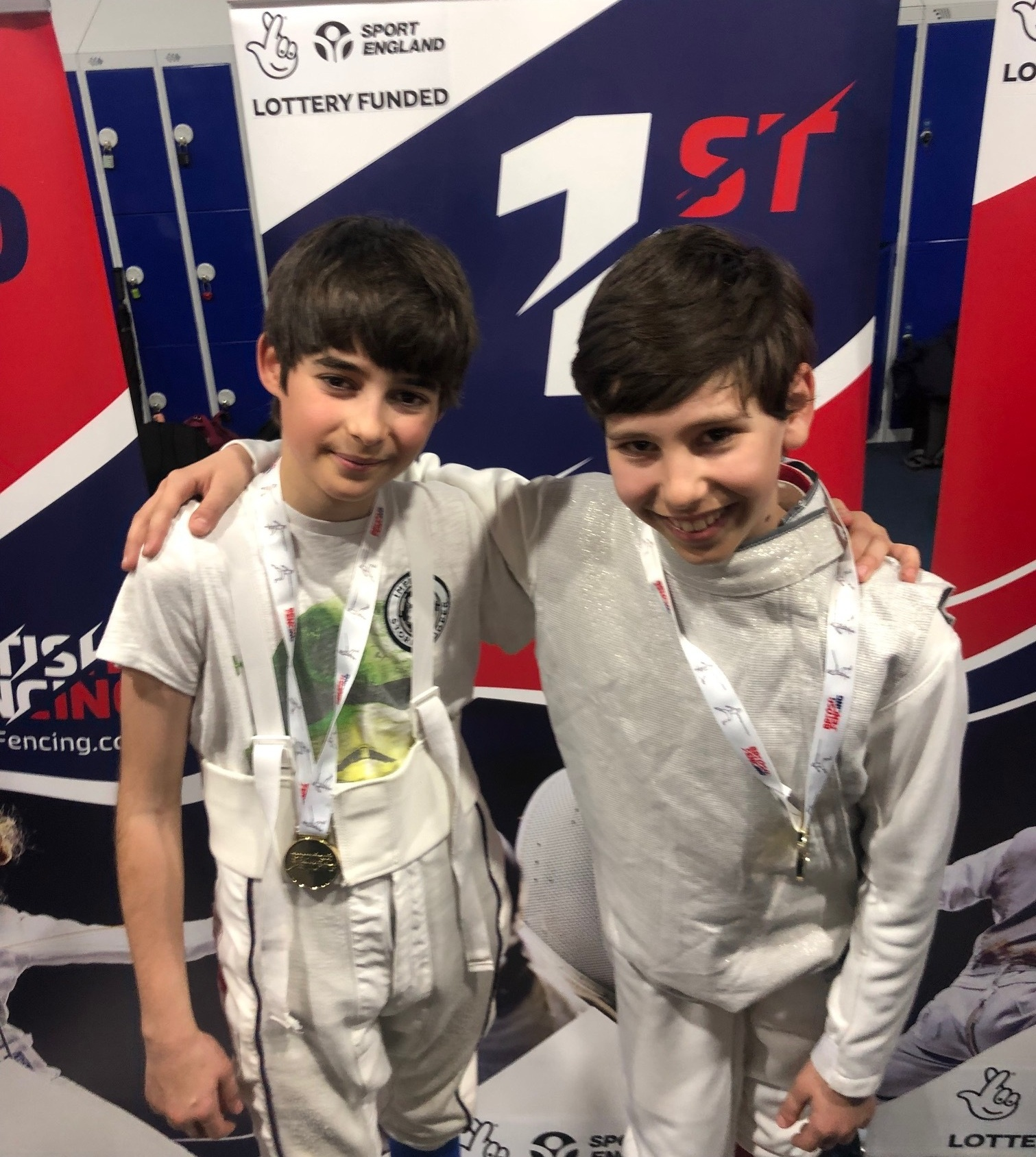 Caspian+and+Sinan+Fencing+Gold+Medal.jpg