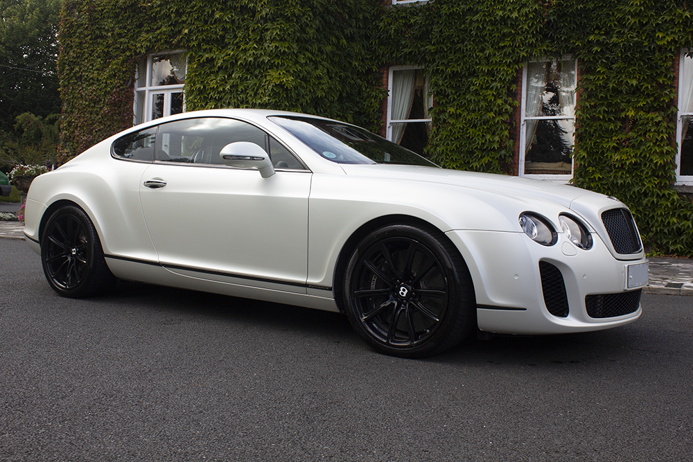 pearl white Bentley Supersport for wedding hire