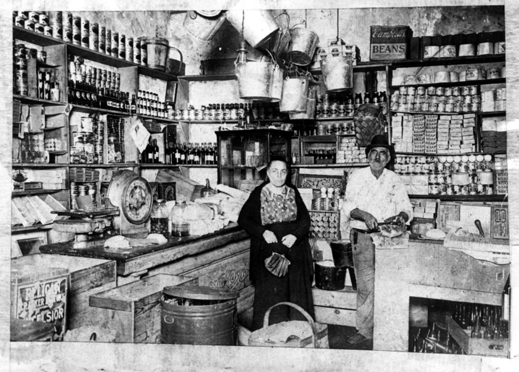 Italian Immigrants running a community grocery store in New Orleans, Louisiana