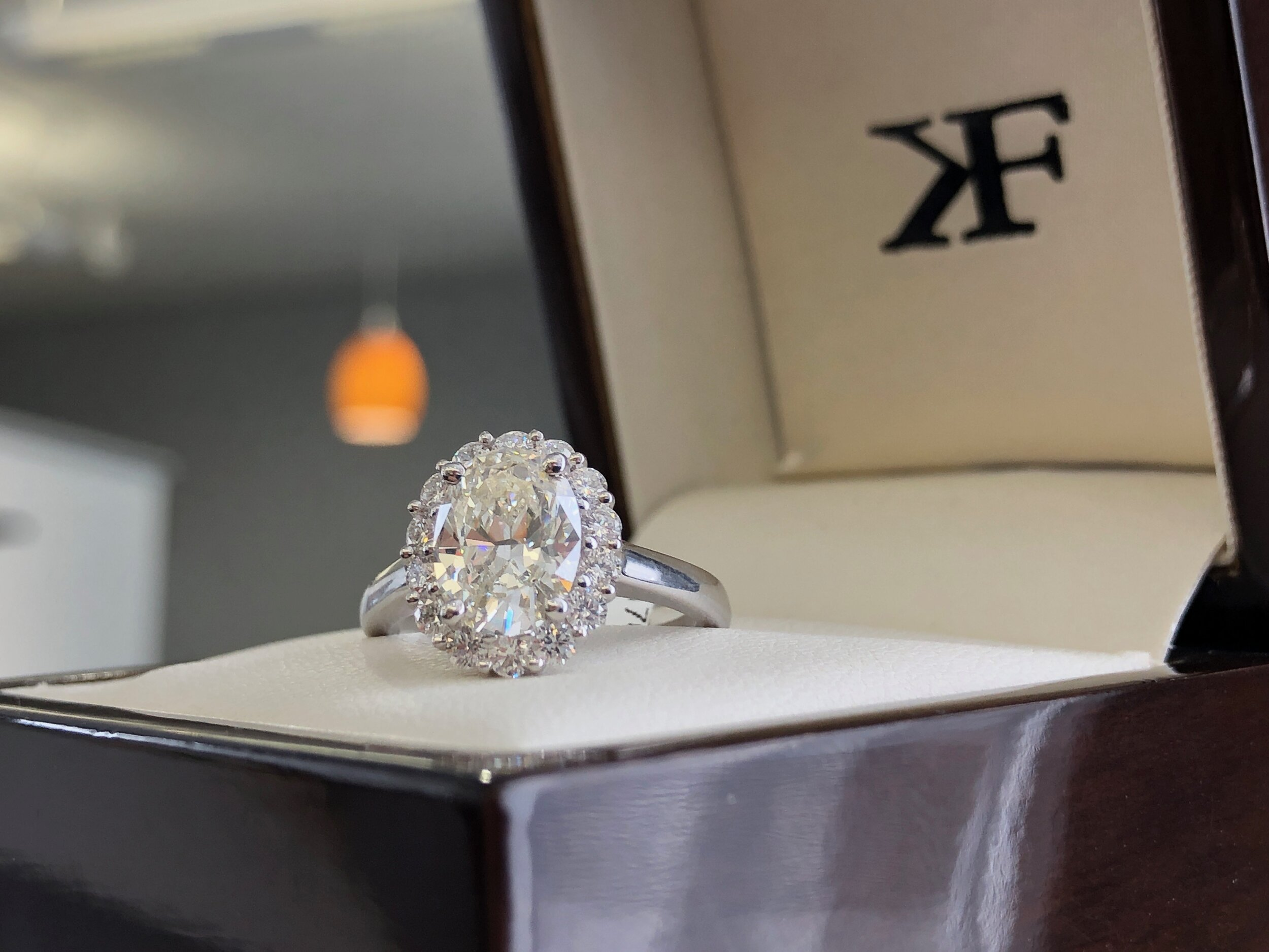 Multi generational family diamond that has been recut and set in a modern halo setting.