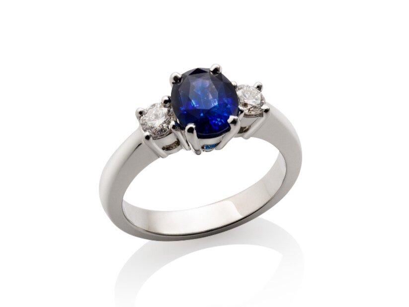Keeping with English royal tradition, blue sapphires are an excellent choice for an engagement ring. This classic three stone is only $4,500 compared to the $11,000+ equivalent if the center stone was a diamond.