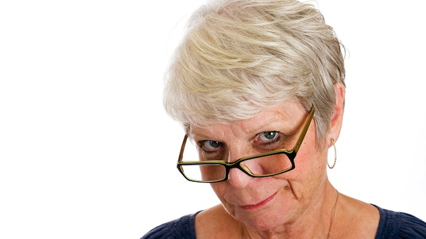Woman-scowling-and-looking-over-the-rim-of-her-glasses-Shutterstock.jpg