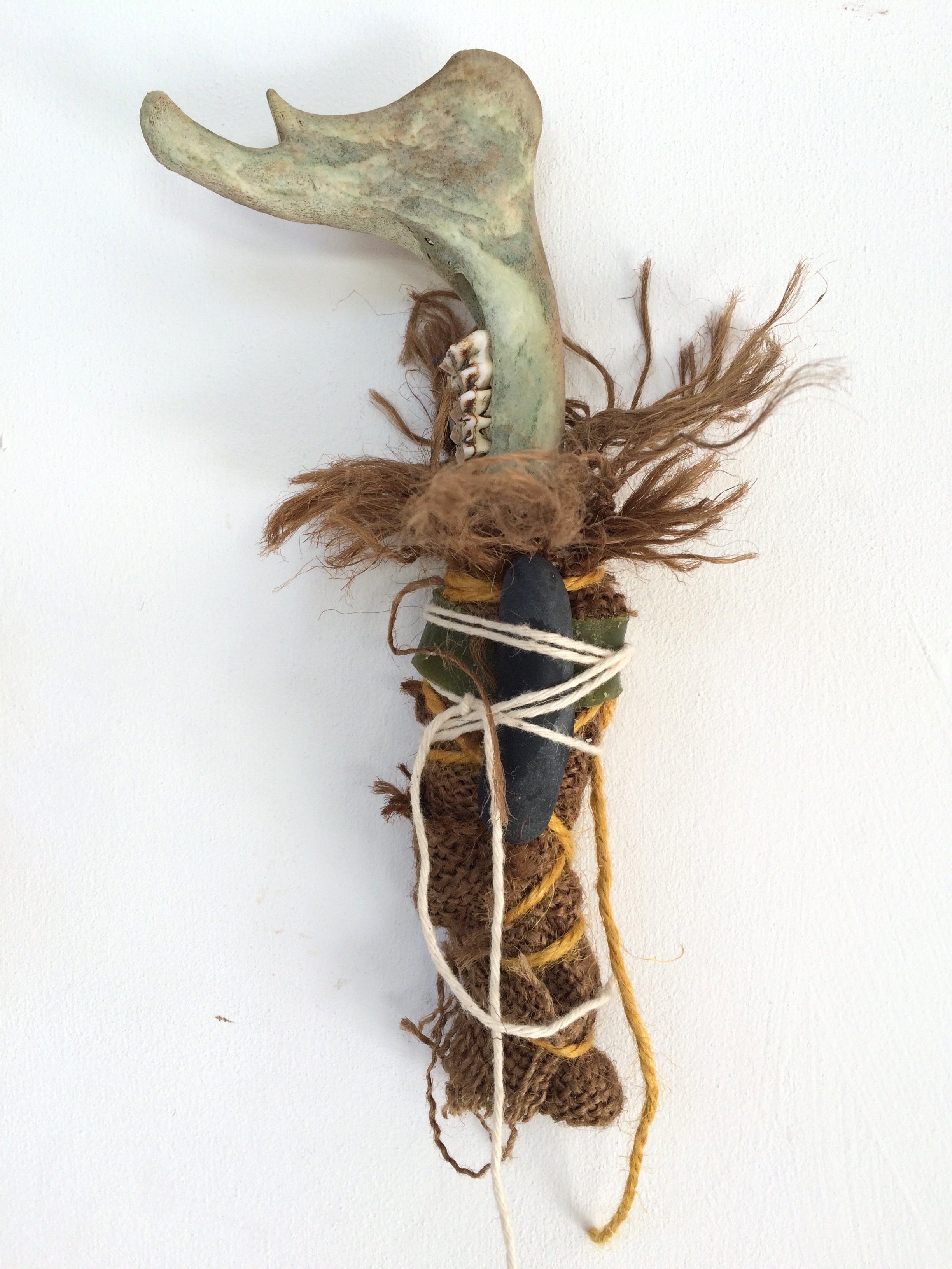 Molly's Bone,  2018 hessian, wax, twine, sheep jawbone, pebble h17cm