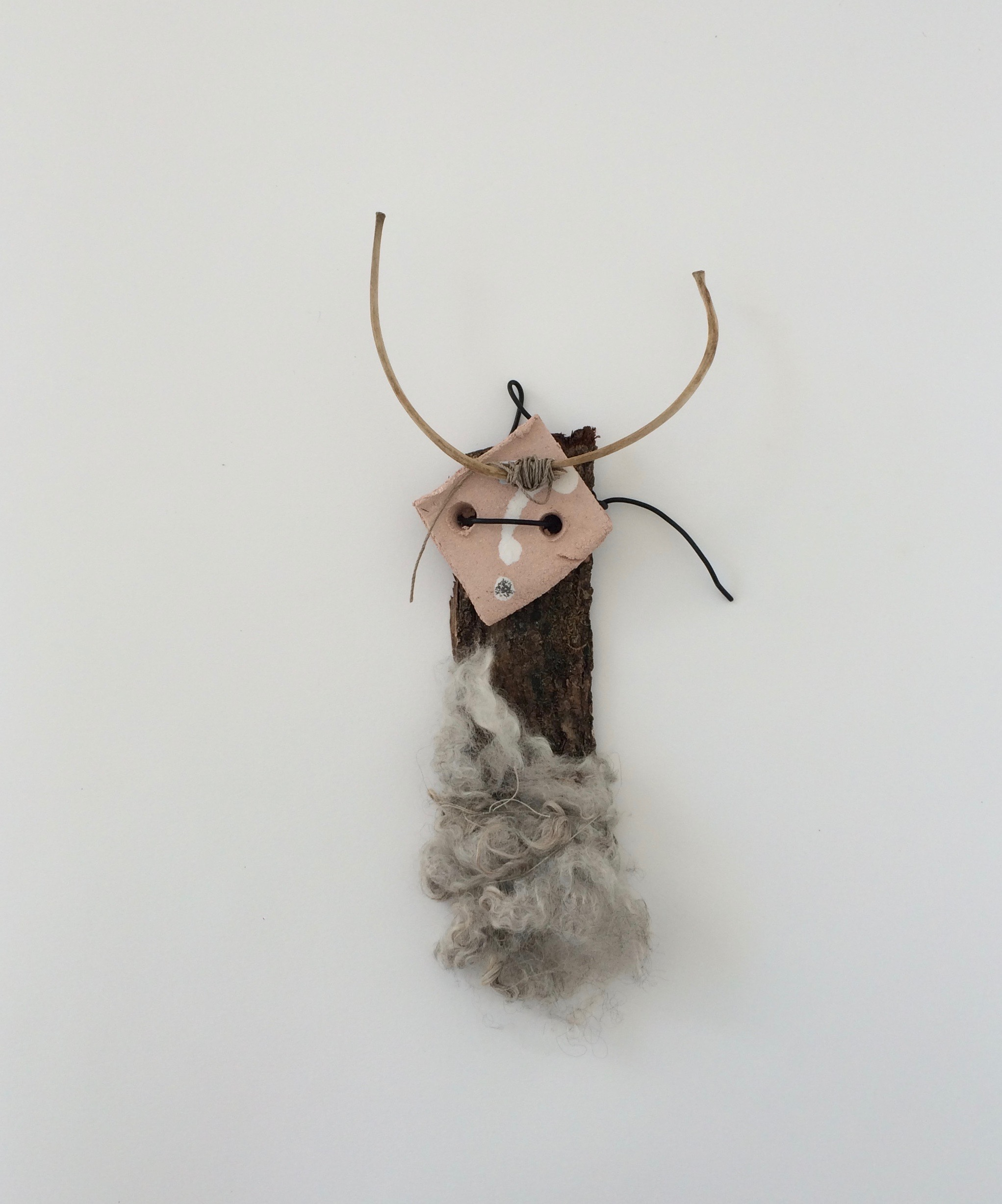 Night Rider,    2018 wood-bark, wool, clay, wool, string, feather h 33cm