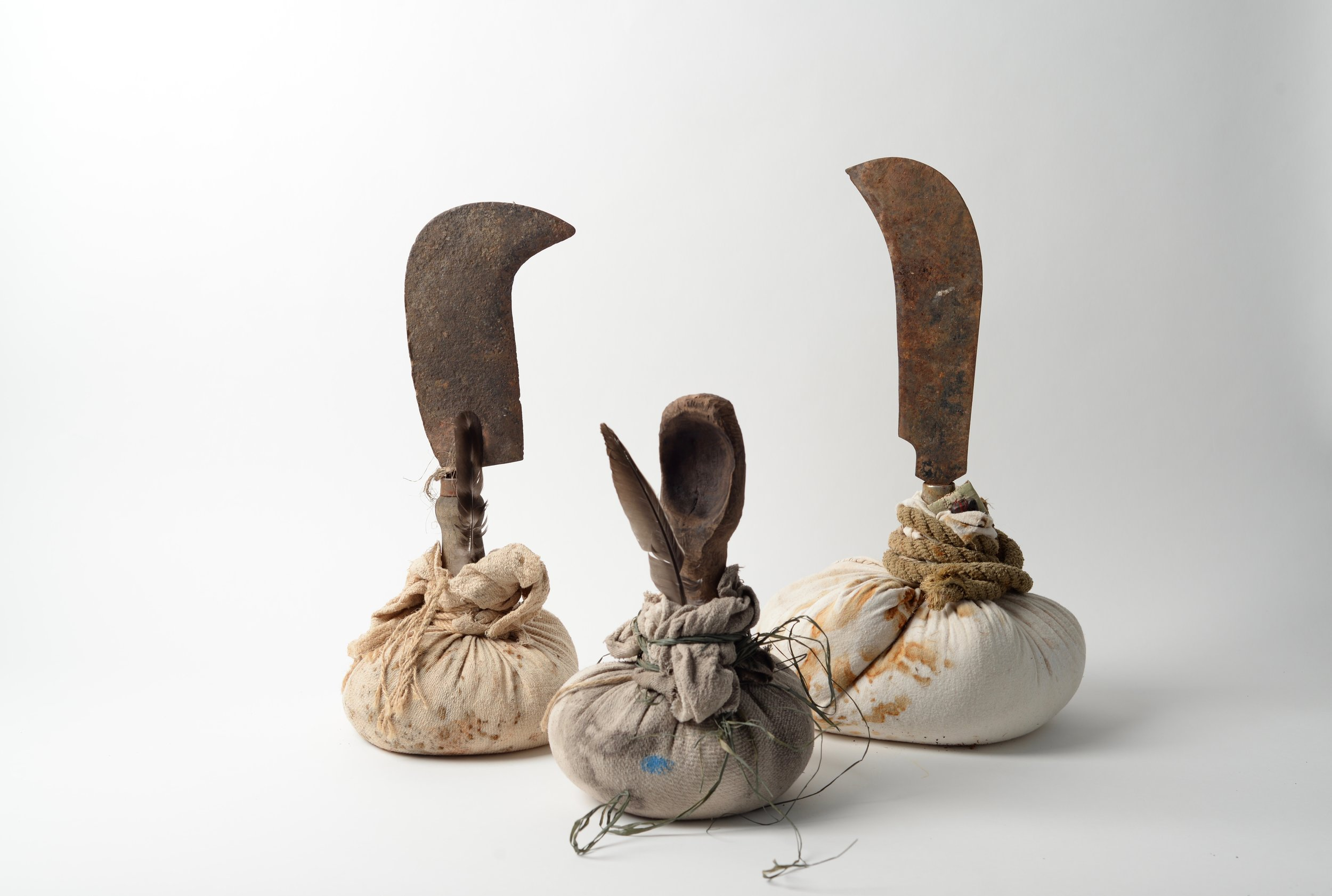 A Family Affair,  2017 bill hooks, rust-printed cotton, rope, string, raffia, feathers, stone, wooden spoon h50cm