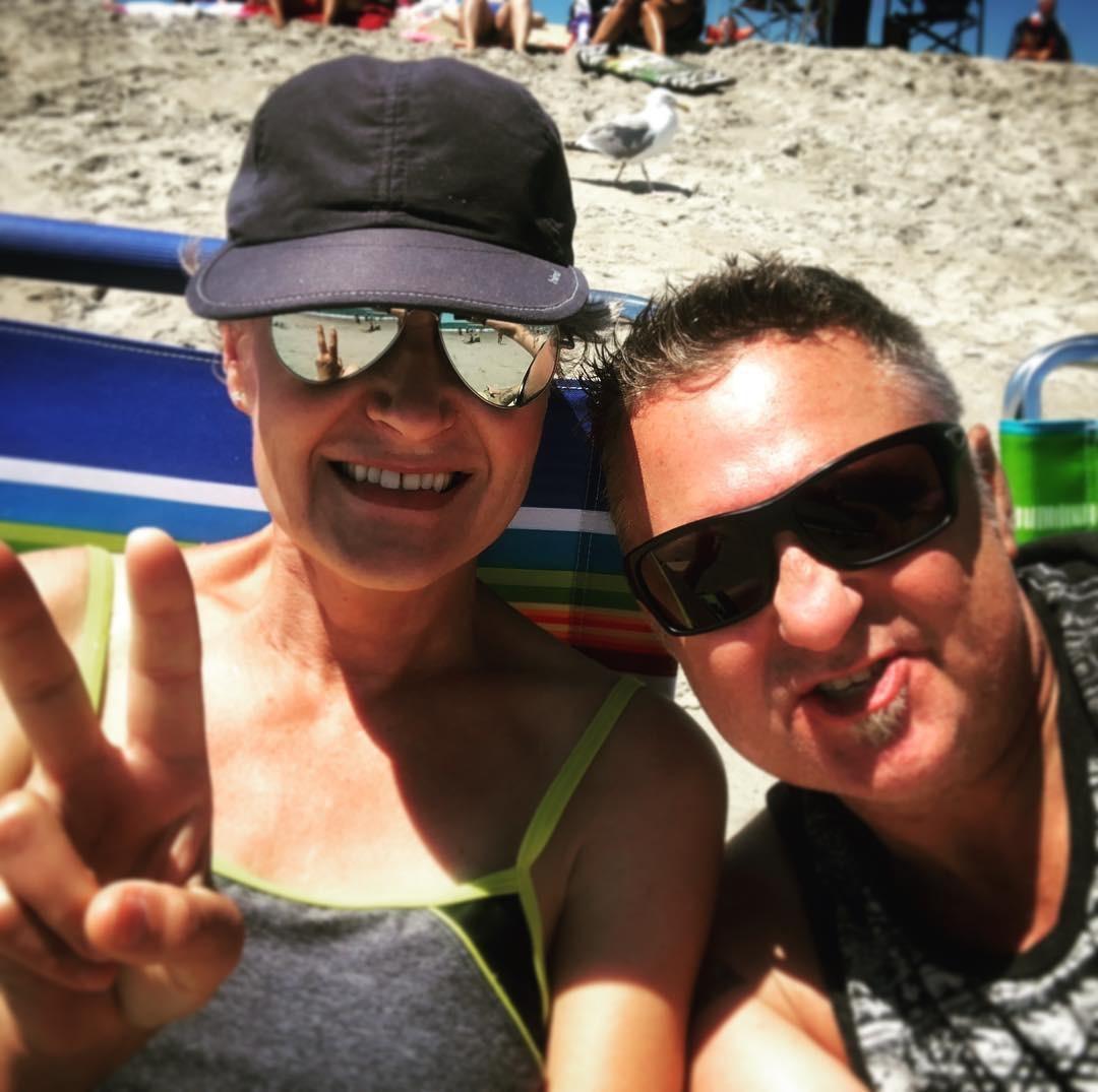 Linnea Olson Stage 4 Lung Cancer (13 year survivor). Sunbathing at Hampton Beach