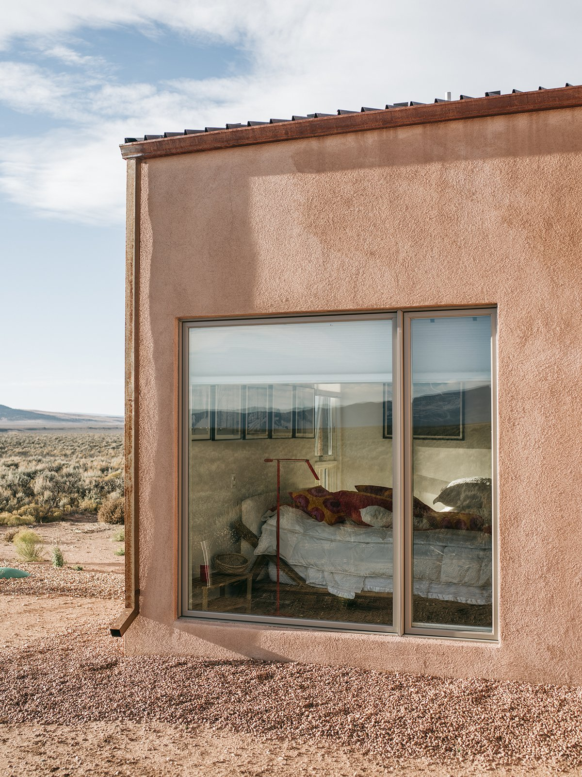 a-gravel-perimeter-keeps-mud-from-splashing-on-the-walls-when-it-rains-adds-molly-you-can-get-away-with-minimal-landscaping-because-theres-so-much-natural-vegetation-here-taos-new-mexico-dwell-magazine-july-august-2017.jpg
