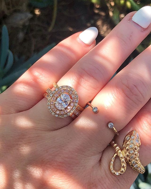 Today's #stacksaturday  Featuring our oval double halo diamond & pink sapphire engagement ring ($6970) stacked with two satin finish  diamond bands ($640/each). Paired with a bezel set diamond ring on the middle finger ($745) and our Italian textured diamond snake ring ($1795). All available in store. DM for details.  #ringsuite #ringstack #ovaldiamondengagementring #ovaldiamondring #haloengagementring #doublehalo #pinksapphire #engagementring #proposal #rosegold #instore #carlsbadvillage #coppercanary