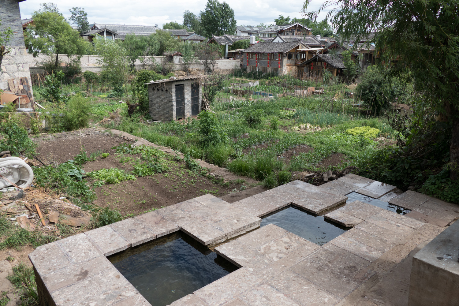 The traditional three water collection pools of Naxi culture