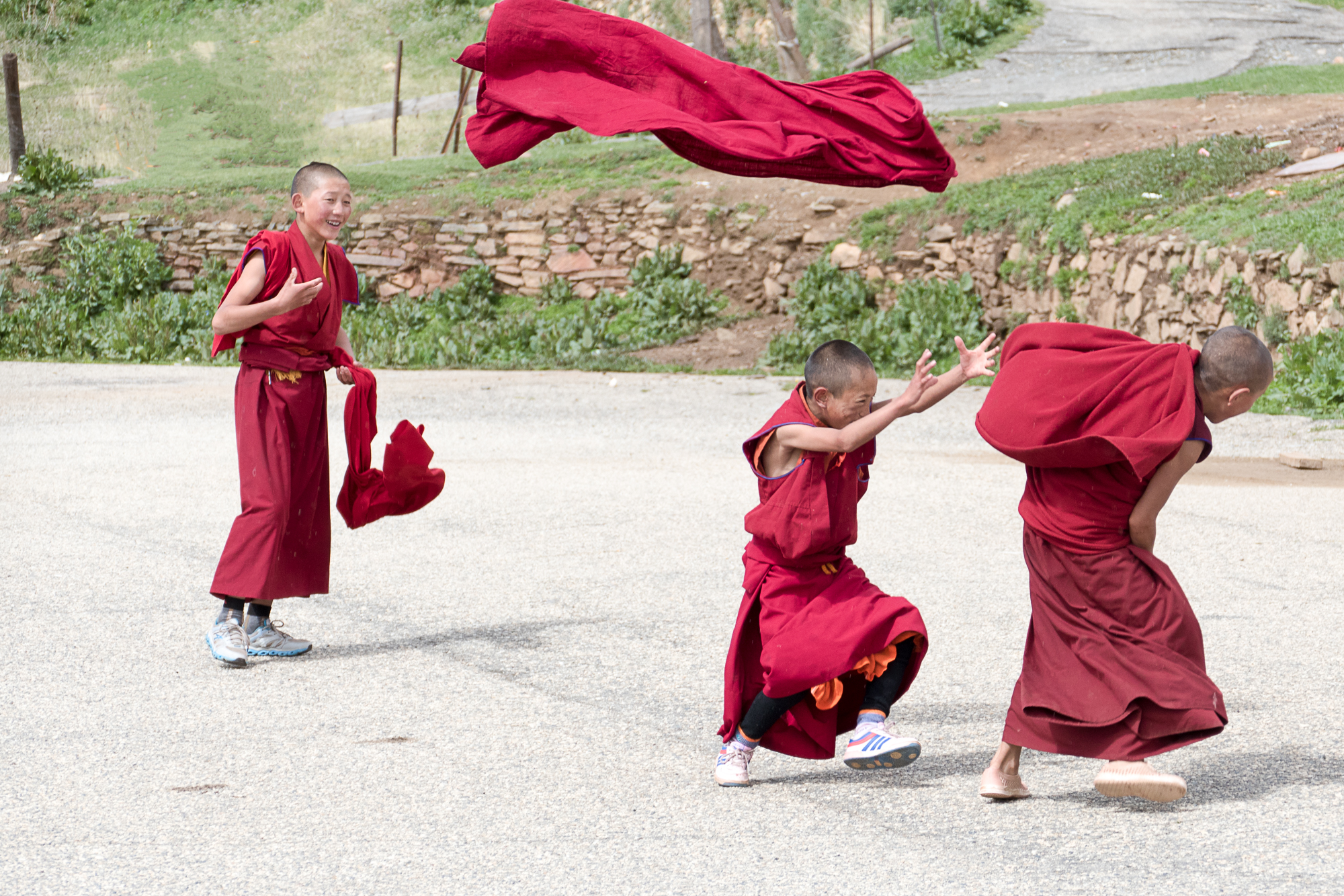Monks in training playing keep-away