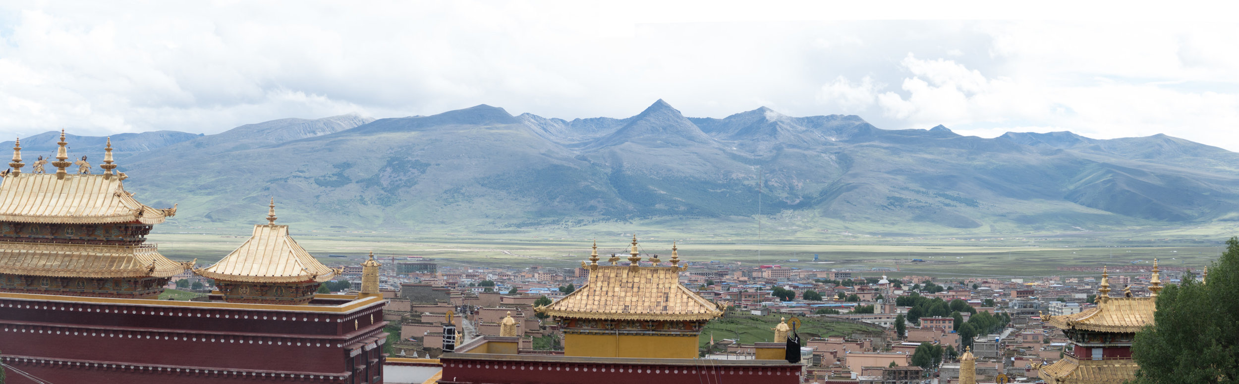 Panorama of the monastery and Lijiang city with mountains in the background