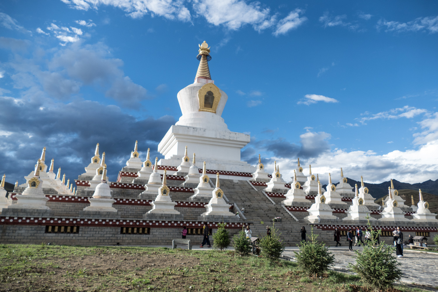 The primary stupa in Daocheng. People can be seen walking around the base and turning prayer wheels as they go.