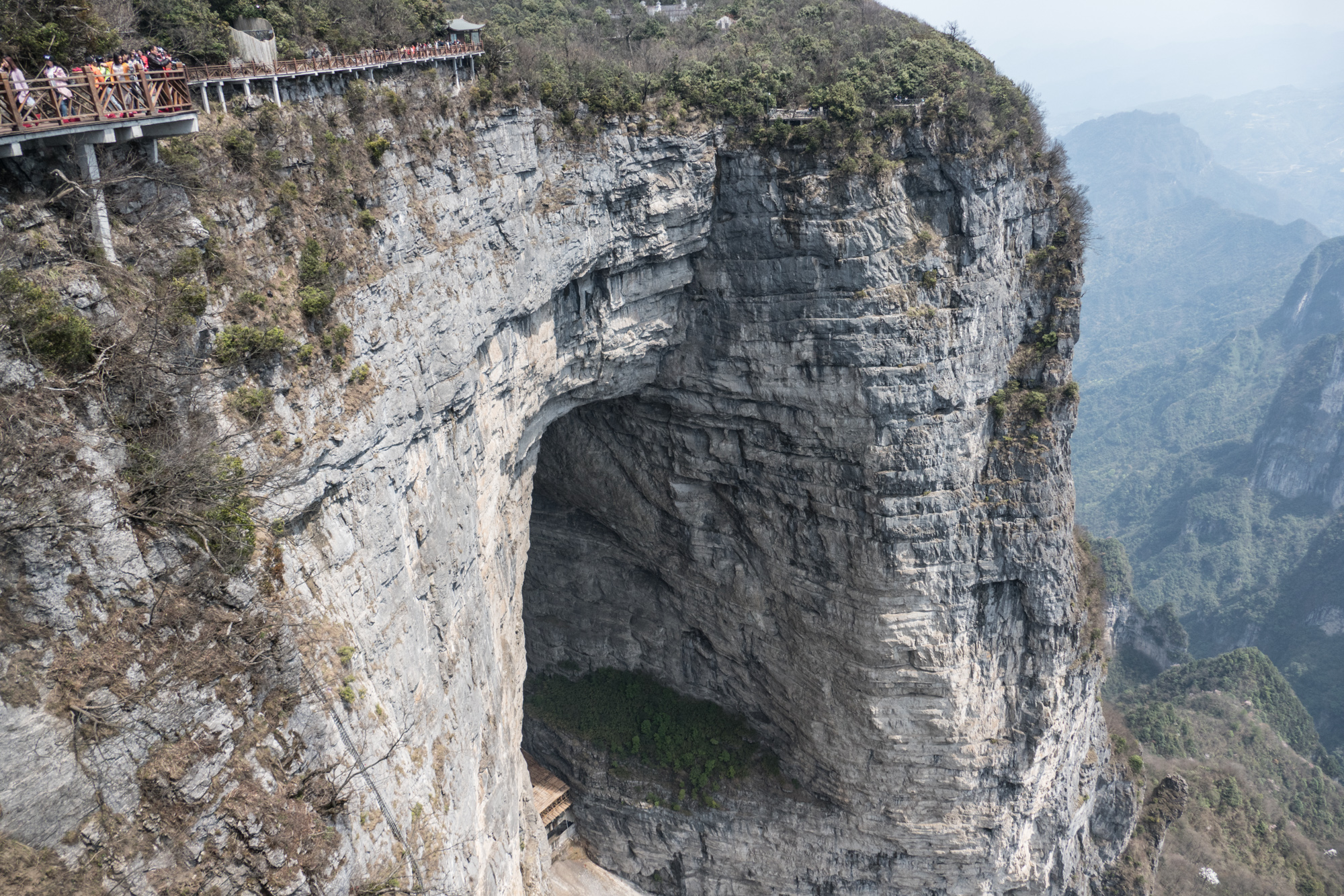 Tianmen means Heaven's gate and the mountain is named after this natural opening, large enough to fly a squadron of planes through it. Note the cliffwalk above the gate and the ladder to the left of the opening