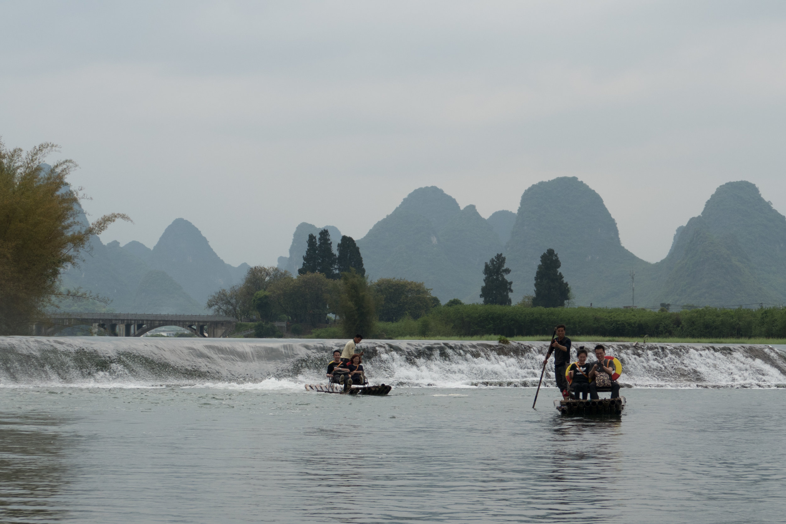 Rafts on the Yulong River with karsts in the background