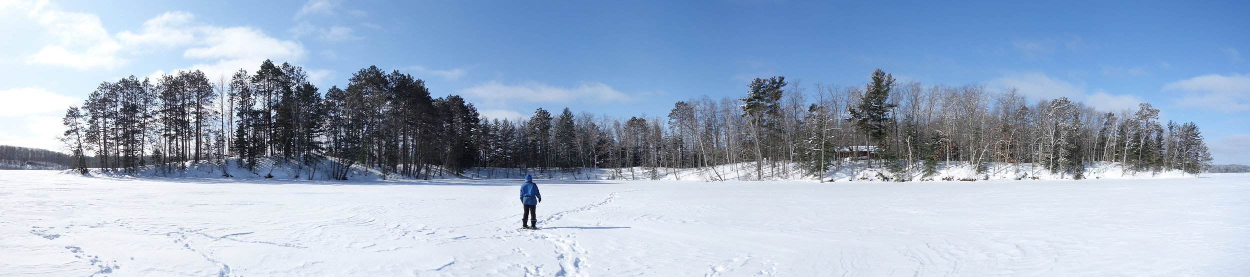Panoramic view of the island from the north in the winter. The cabin is visible through the trees to the right of center