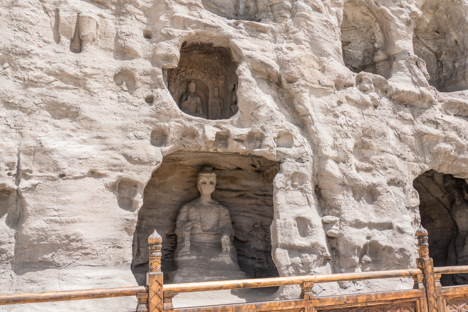 Many statues are in individual caves