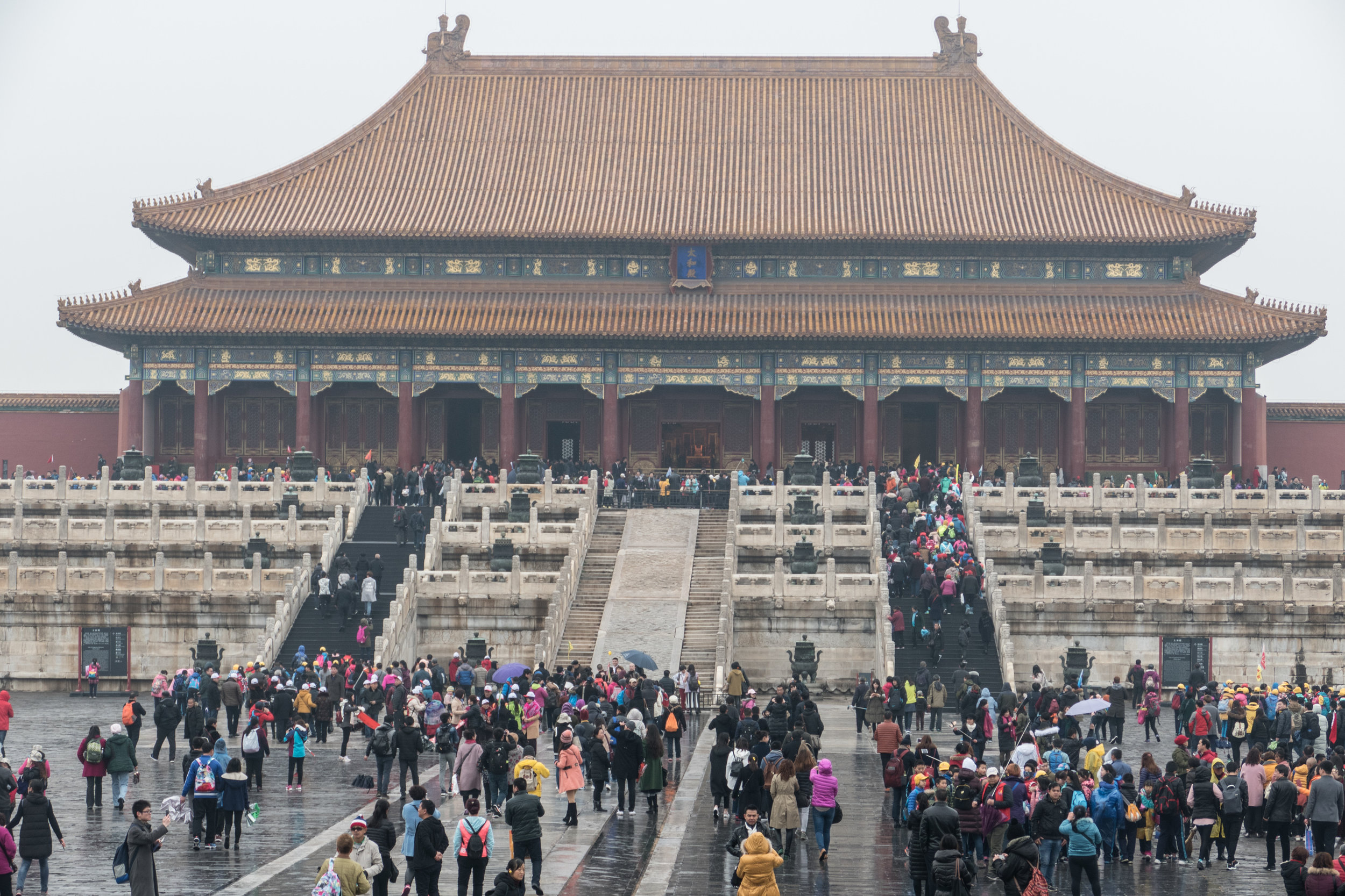 Despite the rain, there were large crowds at the Forbidden City
