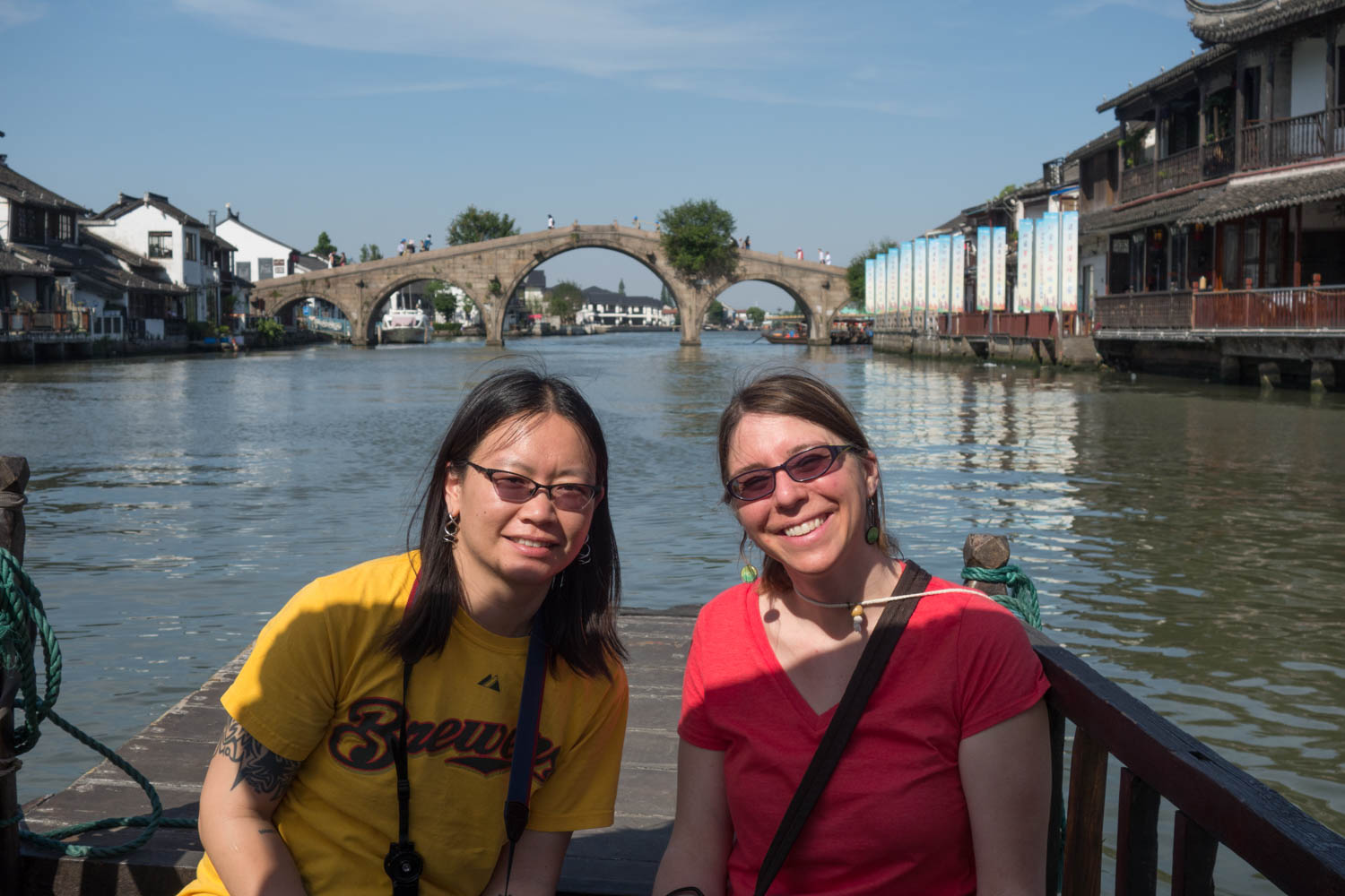 Laura and Sarah on the boat with Fangsheng bridge in the background