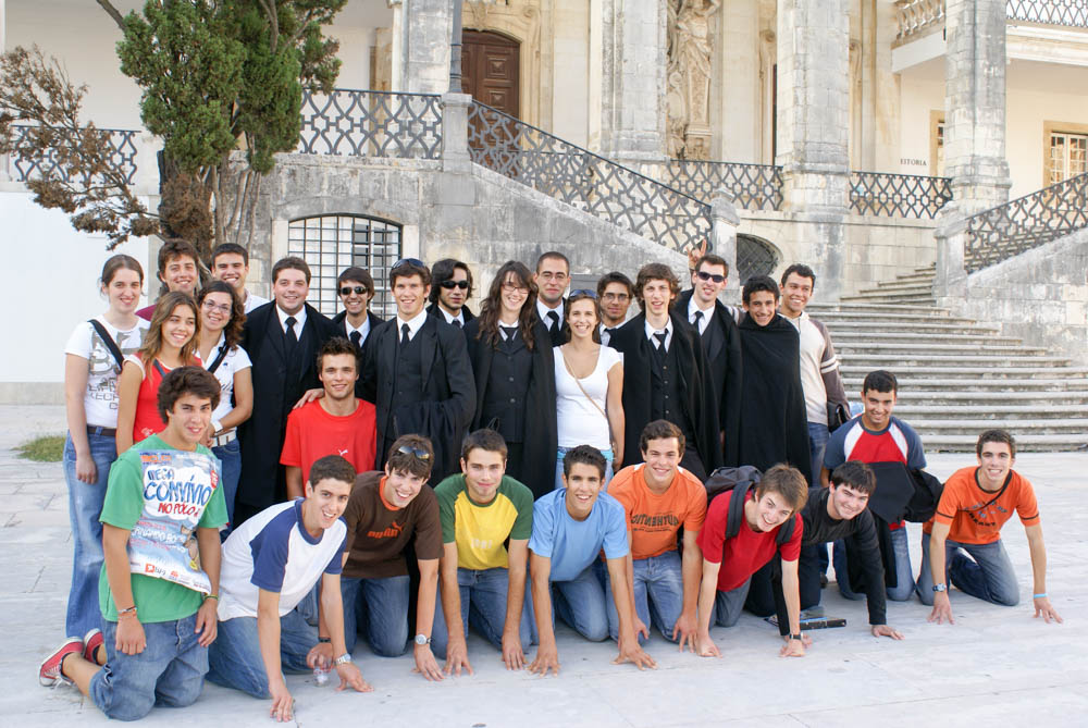 Gathering of students at the University of Coimbra. Some of the students are wearing the ceremonial gown for going around the town.