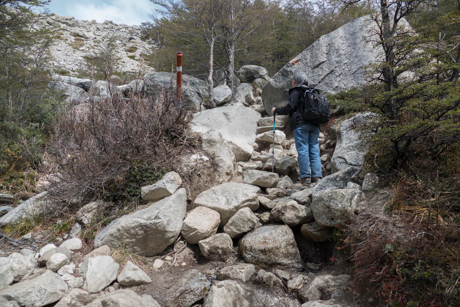 Scrambling up rocks and boulders on the last bit