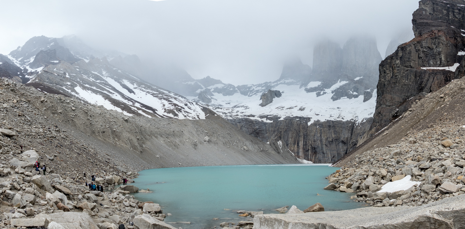Panorama view of the base of the Torres, shrouded in the clouds. At this time it was blowing hard and sleeting. The positive thing was that we made use of all the layers we had carried up the mountain.