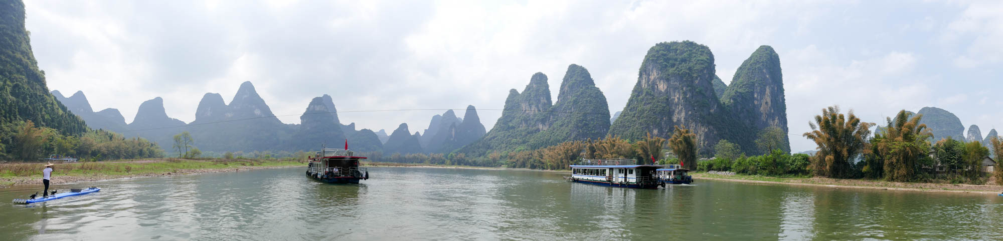 Karsts with tour boats on the Li River.