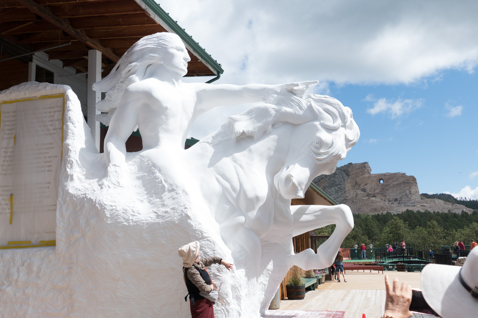 The model of the Crazy Horse Memorial statue in the foreground with the work in progress in the background.