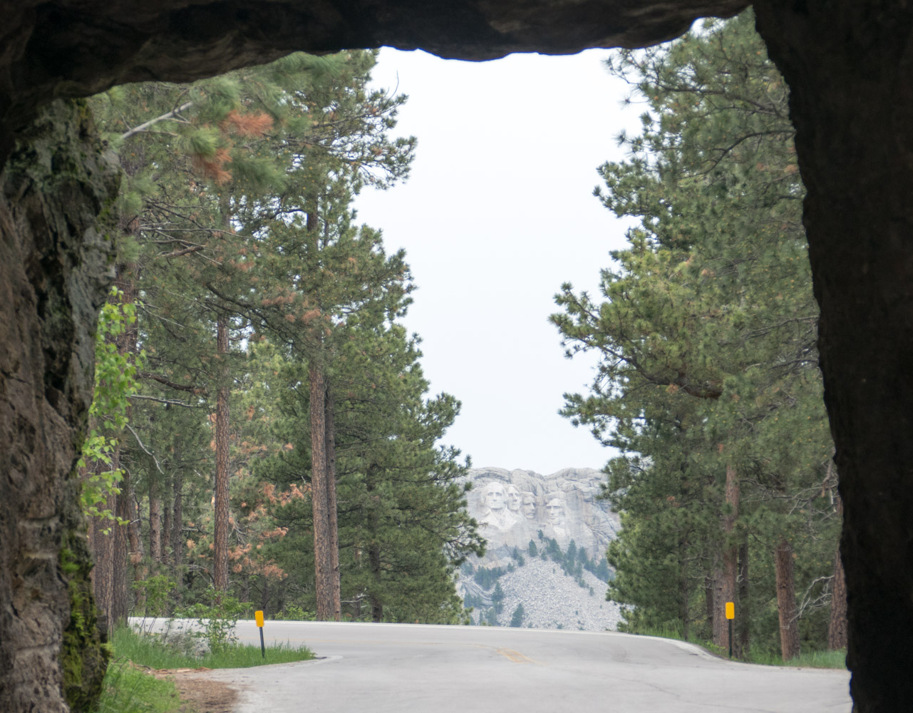A tunnel on the Iron Mountain Road which frames Mt. Rushmore.