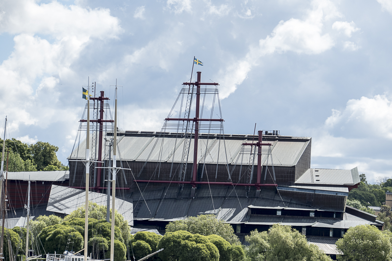The three masts of the Vasa protruding out of the museum where the ship is displayed