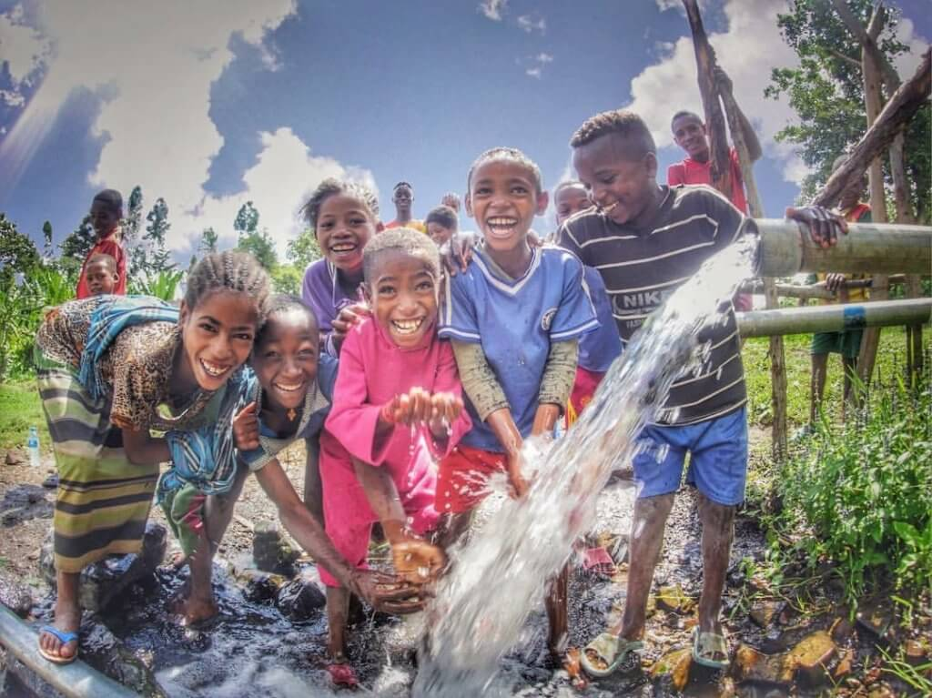 These children will be able to grow up vastly differently from their parents, thanks to the water system made possible by HOPE supporters.